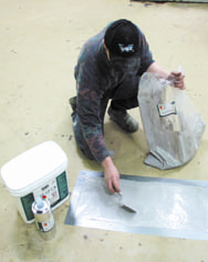 R17 Industrial Concrete Patio Crack Repair Kit Being Applied