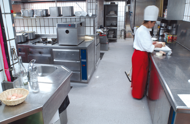 Food Grade Non-Perforated Flooring In Kitchen With Chef