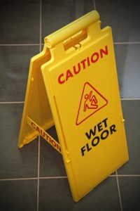 VCT Flooring With Caution Floor Wet Sign