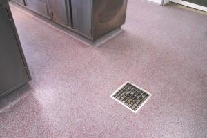 Drain in wet room flooring.