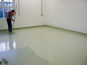 Contractor applying a flame resistant coating to a new floor.