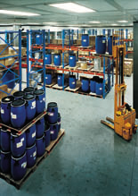 Blue industrial floor with tanks on it.